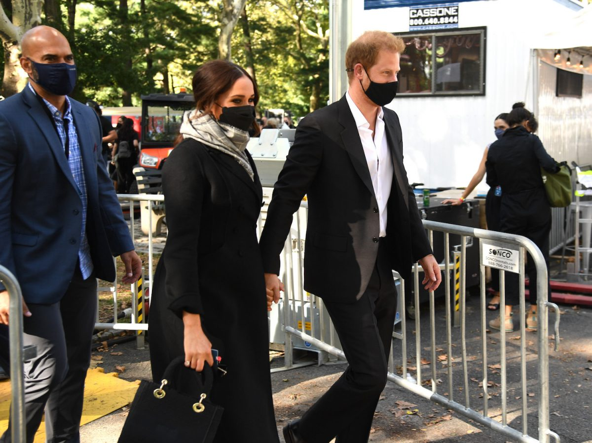 Meghan Markle and Prince Harry arrive at Global Citizen Live wearing face masks and holding hands