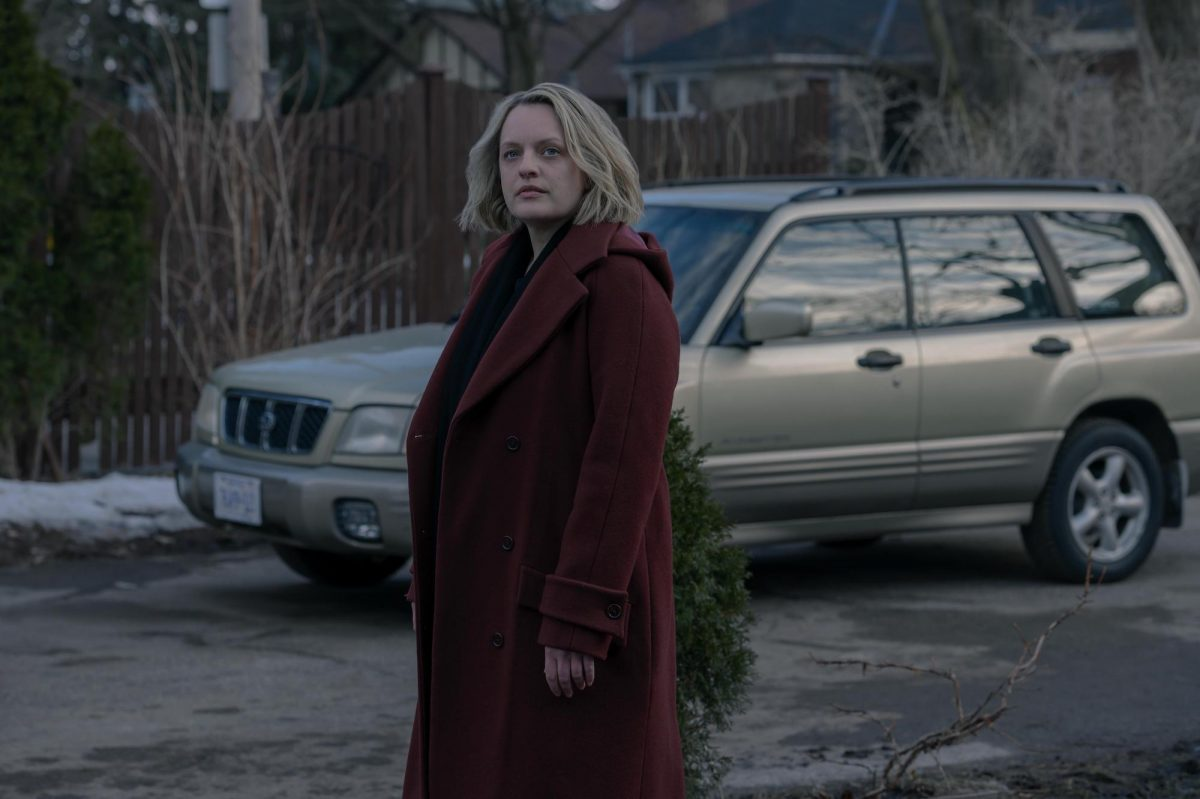 Elisabeth Moss standing in front of a car in 'The Handmaid's Tale.'