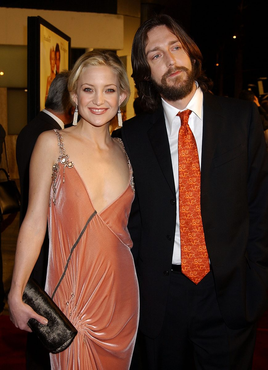 Kate Hudson and Chris Robinson pose together for photos at the 'How to Lose a Guy in 10 Days' Premiere