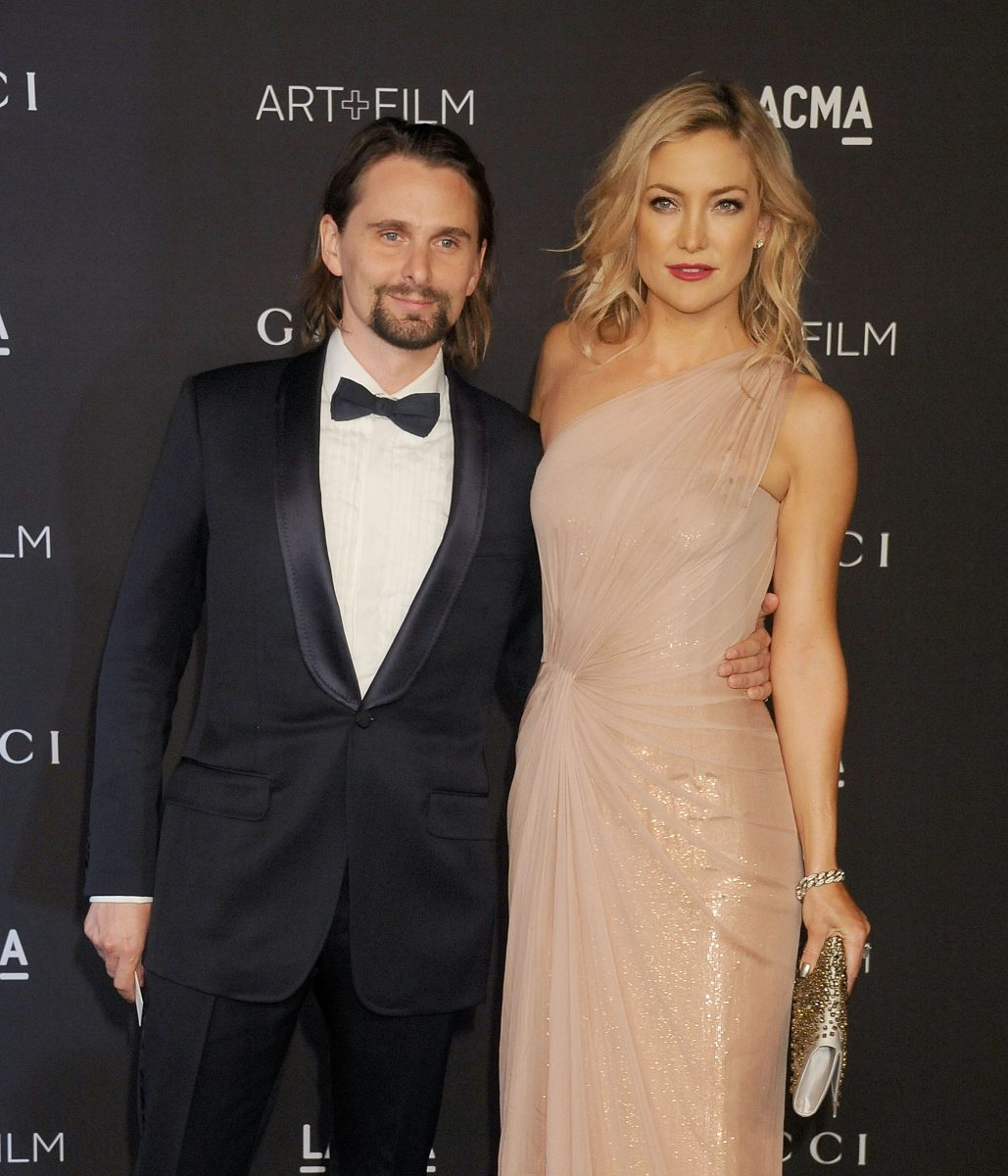 Kate Hudson and musician Matthew Bellamy pose on the red carpet together at the LACMA Art + Film Gala