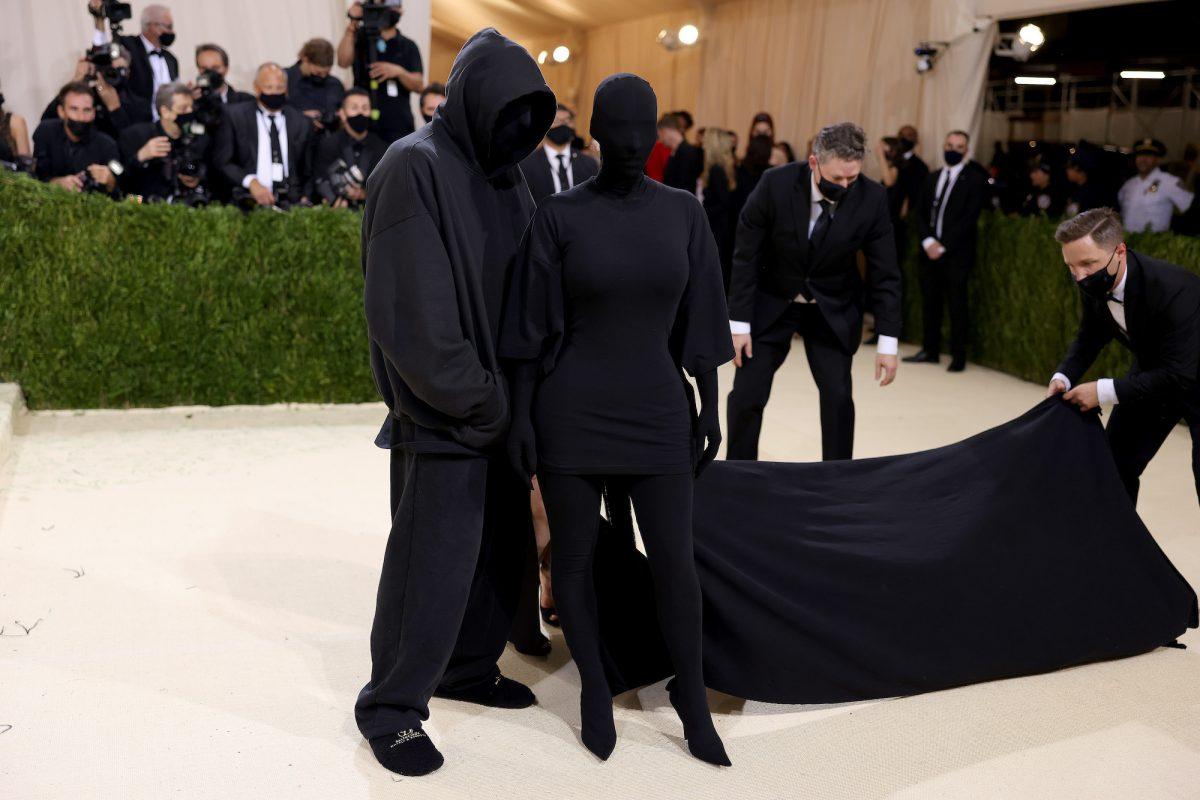 Kim Kardashian West and Demna Gvasalia, the creative director of Balenciaga, posing on the red carpet at the 2021 Met Gala