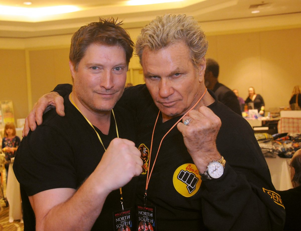 Martin Kove and Sean Kanan pose with their fists