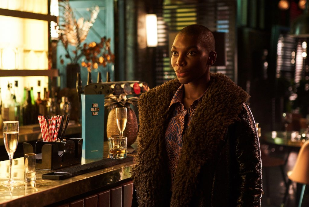Michaela Coel standing next to a bar in 'I May Destroy You.'