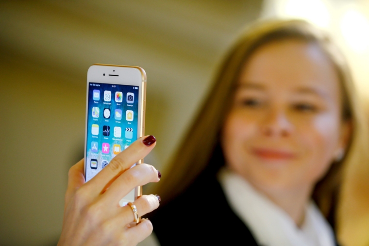 MOSCOW, RUSSIA - SEPTEMBER 29: A woman checks an Apple phone after Apple launched iPhone 8 and 8 plus at the GUM department store in Moscow, Russia on September 29, 2017. (Photo by Sefa Karacan/Anadolu Agency/Getty Images)