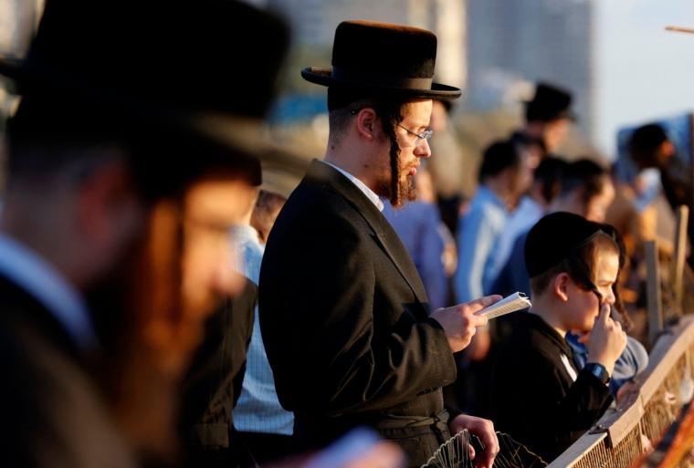 Ultra-Orthodox Jewish men and children perform the