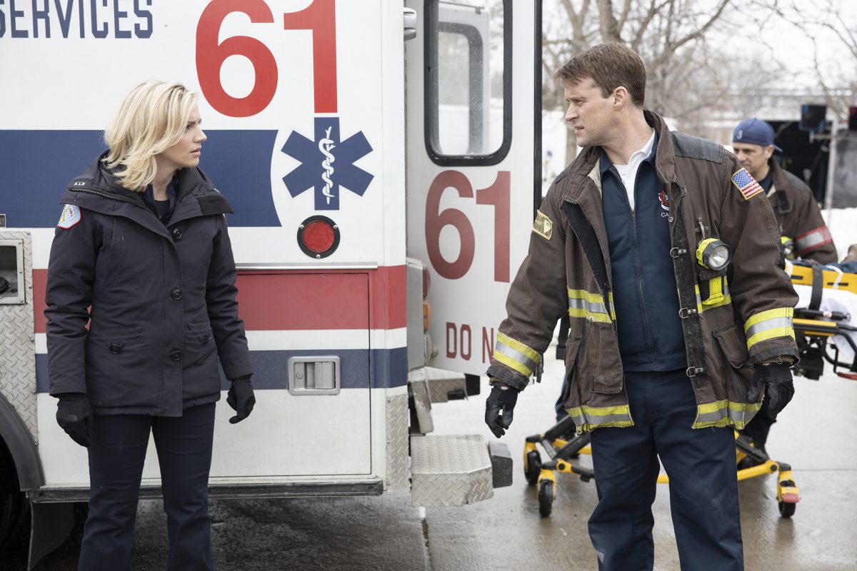 Sylvie Brett and Matt Casey standing in front of an ambulance on 'Chicago Fire'