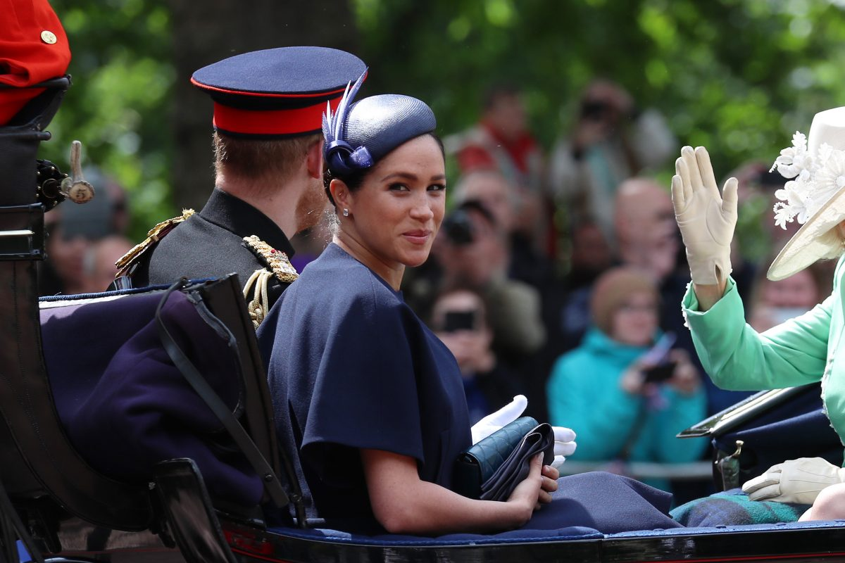 Meghan Markle smiling in carriage during Trooping The Colour 2019