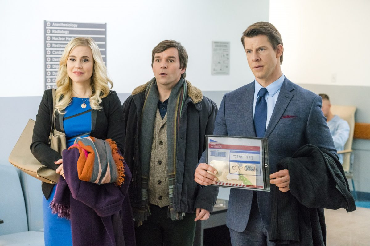 Shane, Norman, and Oliver standing in a row in the Signed, Sealed, Delivered' movie 'From the Heart'